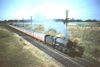 K3 2-6-0 no 61882 takes a train south past the site of the present day Musselburgh station on 16 July 1955. The train is a Saturday morning <I>'Starlight Special'</I> relief working. The Carlisle Canal based locomotive will presumably take the train as far as Newcastle before returning home via the N&C.<br><br>[A Snapper (Courtesy Bruce McCartney)&nbsp;16/07/1955]