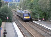 170 419 approaches Dunkeld with a busy (as always) Inverness to <br> Edinburgh service on 20 September.� This track is bidirectional and is used by all passenger services except the one a day which needs to cross here, and the odd special [see image 20750].� The difference in track usage is obvious, and the approach signalling shows that Platform 2 is not bidirectional but Down only.<br> <br><br>[David Panton&nbsp;20/09/2010]