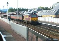 A northbound parcels train halted at the north end of Aviemore station on 25 September 2004 behind EWS 67024.<br><br>[John Furnevel&nbsp;25/09/2004]