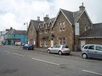 The well preserved station building at Kirkcudbright, looking south along the main street. Behind the building, where the trainshed and platforms were once situated, residential apartments have been built and joined on to the old station, which is currrently used as a fitness studio.<br><br>[Mark Bartlett&nbsp;19/09/2010]