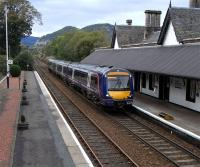 On 20 September 170 419 pulls into Dunkeld & Birnam with an Inverness to Edinburgh service .  Note the low platforms and the steps which through careful driving will be matched up to the doors.  Dunkeld was as far as you got for the first seven years of the Highland main line's existence, so the track would have come to an end about where it disappears in this picture.  As well as an overall roof here there were extensive goods sidings (of which a fragment remains) running behind the station and towards Birnam, a site now covered by the A9. When this was the railhead for the Highlands they would have been rather busy.<br><br>[David Panton&nbsp;20/09/2010]