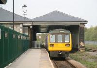 A Saltburn - Bishop Auckland DMU leaves Darlington North Road in April 2009. The buildings to the left of the green fence now form part of the Railway Museum. <br><br>[John Furnevel&nbsp;24/04/2009]