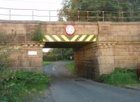 <I>Badger Bridge</I> was a well known WCML spotting location in steam days as it overlooked Brock water troughs. The badger is the emblem of the Fitzherbert-Brockholes family from nearby Claughton Hall. Less well known is this low bridge carrying the main line over Stubbins Lane, a little further north, but which also has four badger emblems on each side. <br><br>[Mark Bartlett&nbsp;09/09/2010]