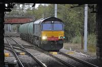 DRS 66420 passes Whifflet North Junction with an oil tank train, heading south. The 66 is thought to be on hire from DRS.<br><br>[Bill Roberton&nbsp;27/09/2010]