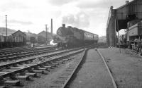 Standard class 4MT 2-6-4T no 80070 takes a train away from Oswestry on the old Cambrian line to Whitchurch on 2 April 1963. The train is about to pass Oswestry shed on which a 14XX 0-4-2T and a pannier tank can be seen.<br> <br><br>[K A Gray&nbsp;02/04/1963]