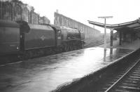 Stanier Pacific no 46225 <I>Duchess of Gloucester</I> runs into a rain soaked Carlisle station on 28 December 1963 with a down parcels train.<br><br>[Robin Barbour Collection (Courtesy Bruce McCartney)&nbsp;28/12/1963]