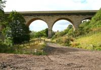 The north end of Newton Cap Viaduct on 30 September 2010 looking west from a track alongside the appropriately named 'Eleven Arches Golf Range'. The River Wear runs past on the left with the town of Bishop Auckland standing beyond. The 153 year old structure, designed by Richard Cail on behalf of the North Eastern Railway and opened in 1857, now carries road traffic on the A689. [See image 30910]    <br><br>[John Furnevel&nbsp;30/09/2010]