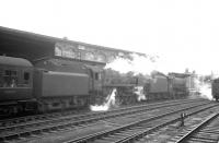 Black 5 no 45029 joins BR Standard Pacific no 72007 <I>Clan Mackintosh</I> on the 8am Aberdeen - Manchester train about to leave Carlisle in July 1964. The <I>Clan</I> had brought in the train from the north.<br><br>[K A Gray&nbsp;18/07/1964]