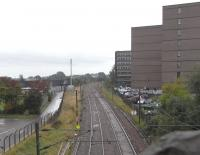 Standing on London Road in September 2010, looking down on where Bill Jamieson was looking up in 1972 [see image 27804].� St Margarets shed was to the right of the ECML on a site now occupied by dull government office blocks, one of which is currently empty.� To the left of the line ran Clockmill Lane, at the far end of which was the entrance to Piershill station.� The lane was obliterated for the construction of outbuildings for Meadowbank Stadium, opened for the Commonwealth Games, 40 years before the current games in Delhi.� <br> <br><br>[David Panton&nbsp;29/09/2010]