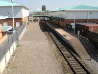 The relocated Wrexham Central single platform terminus looking east to the buffers on 22 April 2010. The station was formerly located some 100 metres beyond here at the far end of the retail park. [See image 30963]<br><br>[David Pesterfield&nbsp;22/04/2010]