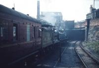 Caley 123 and NB 256 leave Kelvin Hall heading west. The station was<br> renamed from Partick Central in advance of the 'Scottish<br> Industries Exhibition' in September 1959, during which time a two week programme of 'Excursions by Historic Locomotives' was run in connection with the exhibition. The photograph is taken from the west end of the island platform. The scrapyard in the background remained in operation until the 1990s.<br><br>[A Snapper (Courtesy Bruce McCartney)&nbsp;/09/1959]