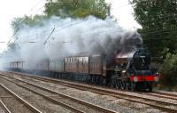 Creating quite a smokescreen as it travels north on the WCML just north of Euxton Balshaw Lane on 2 October, ex-LMS Jubilee no 5690 <I>Leander</I> heads the <I>Severn Valley Limited</I> railtour from Bridgnorth to Blackpool.<br><br>[John McIntyre&nbsp;02/10/2010]