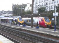 A pair of passing Class 220s makes a welcome change from the usual <br> diet of ScotRail units at Haymarket on 2 October 2010. There's a handy alliteration in 'Virgin Voyager', with Voyager being the name of the class and not a Virgin brand per se. The name therefore applies equally to the Cross Country set on the left.<br> <br><br>[David Panton&nbsp;02/10/2010]