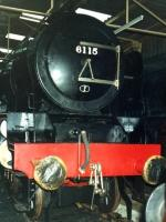 6115 <I>Scots Guardsman</I> in the display shed at the former Dinting Railway Centre on 5 January 1980. Other locomotives on display that day included no 60019 <I>Bittern</I> that can just be seen sitting on the adjacent road. <br><br>[David Pesterfield&nbsp;05/01/1980]