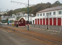 The Derby Castle terminus of the Manx Electric Railway in Douglas is directly outside the horse tram depot. The simple track layout contrasts sharply with the points and crossovers of the horse tramway behind. Arriving electric trains uncouple from their trailer, draw forward and then reverse out of the way. The trailer is then gravity shunted onto the single line in front of the booking office at which point the electric train drops back and couples ready to go back to Laxey and Ramsey. Trains continue to run until the first week in November although there are only four per day each way in Autumn.<br><br>[Mark Bartlett&nbsp;08/10/2010]