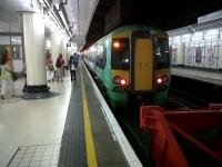 A 377 for Portsmouth and Southsea prepares to leave platform 18 at Victoria in July 2010.<br><br>[Ken Strachan&nbsp;03/07/2010]