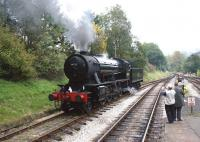 Ex-WD 2-8-0 no 90733 runs round its train at Oxenhope on 9 October <br> 2010.<br> <br><br>[John McIntyre&nbsp;09/10/2010]