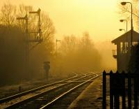 Dawn breaks over Brundall station, Norfolk, in February 2010. The line to the left is for Great Yarmouth and to the right for Lowestoft.<br><br>[Ian Dinmore&nbsp;06/02/2010]