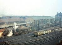 Steam more dead than alive in this mid 1960s shot from London Road showing the south side of St Margarets shed, with V2 60816 centre-stage. Note the wagons dropping below ground level for spent ash collection, and, in the right background, the downwind (and long-suffering) flats on Restalrig Road North.<br><br>[Frank Spaven Collection (Courtesy David Spaven)&nbsp;//]
