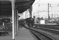 View from the platform of Rheine station in the summer of 1976 as DB 043-196-5 sets off for Emden with a freight. <br> <br><br>[Peter Todd&nbsp;17/06/1976]