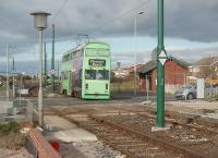 With new platforms under construction in the foreground, tram 762 rumbles across the crossing at Rossall School. 762 is one of the <I>Jubilee</I> class of two trams that were rebuilt with East Lancs bodies and which seemed considerably larger than all the other trams in the fleet. After withdrawal in 2011 it moved to the National Tramway museum at Crich. The large waiting shelter at this tram stop was demolished when the new halt was completed. [See image 22575] for the same view eighteen months earlier.<br><br>[Mark Bartlett&nbsp;16/10/2010]