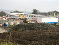 View east over the new station at Armadale on 12 October 2010 showing work underway on access roads, parking etc on the north side of the site. Part of the town of Bathgate can be seen in the left background.<br><br>[John Furnevel 12/10/2010]