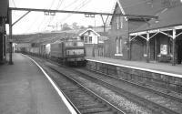 An EM1 electric locomotive runs west through Dinting towards Manchester in May 1969 with a Woodhead route freight.<br><br>[K A Gray&nbsp;/05/1969]