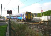 One of the limited stop services on the Glasgow Central - Edinburgh route about to run through Kirknewton station on 12 October. The train is on the well known level crossing which it is planned to replace with an underpass.<br><br>[John Furnevel&nbsp;12/10/2010]