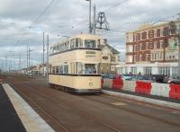 Restored Sheffield tram 513 is on long term loan to the Blackpool system from Beamish and is used with other preserved trams in ordinary service on busy days and special events. It was the last four wheeled design built in the UK but only lasted eight years in service before the Sheffield tram system closed in 1960. 513 is seen here running through the new platforms at Cabin.<br><br>[Mark Bartlett&nbsp;16/10/2010]