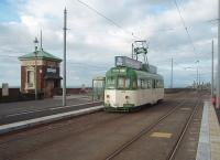 Restored 1937 built Brush railcar 632, owned by the Lancastrian Transport Trust, is seen here operating in Blackpool again as part of the celebrations of the 125th aniversary of the tramway system. During its restoration it has been refitted with illuminated roof mounted advertising boxes, so much more attractive than the overall advertising liveries that have been a feature of recent years. The 73 year old tram is just about to reverse at Cabin and return to the Pleasure Beach and is seen here in the new platforms with the Cabin Lift behind. <br><br>[Mark Bartlett&nbsp;16/10/2010]
