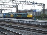 Freightliner 86639 leads sister locomotive 86621 through Manchester Piccadilly platform 14 early on the evening of 2 September 2010 with an intermodal working bound for Trafford Park terminal. <br><br>[David Pesterfield&nbsp;02/09/2010]