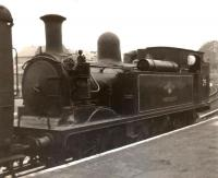 Adams O2 class 0-4-4T no 29 <I>Alverstone</I> standing at what is thought to be Cowes Station on the Isle of Wight on 7 December 1962.<br><br>[David Pesterfield&nbsp;07/12/1962]