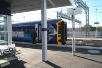 The 11.24 service to Edinburgh Waverley about to commence its journey from the new Bathgate station on 20 October 2010. The additional roads beyond the (as yet) unused westbound platform are part of the ScotRail light maintenance depot recently constructed on the south side of the line. <br><br>[John Furnevel&nbsp;20/10/2010]