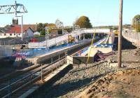 Progress on the new station at Caldercruix on 20 October 2010. Photographed looking west from the embankment alongside the currently closed bridge carrying Main Street over the formation. [See image 21918]<br><br>[John Furnevel&nbsp;20/10/2010]