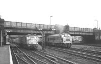 The north end of Carlisle in late 1968 sees a 'Peak' leaving on the 10.25am  Leeds - Glasgow Central with a type 2 standing at platform 7 with the 1pm Carlisle - Edinburgh Waverley via Hawick.<br><br>[K A Gray&nbsp;//1968]