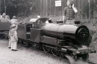 Two mini-enthusiasts admire the locomotive on the miniature railway (15' gauge?) that used to run along the western perimeter of the site at Steamtown, Carnforth, passing through the loco shed on the way.<br> <br><br>[Colin Miller&nbsp;//1979]