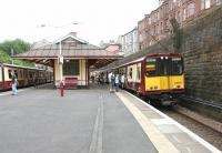 Trains on the Cathcart Circle meet at Queens Park in July 2005. View south east towards Victoria Road with the tenements of Torrisdale Street standing above the station on the right.  <br><br>[John Furnevel&nbsp;03/07/2005]
