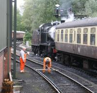 PW checks being carried out at the entrance to Pickering station on 26 September 2010 as ex-Somerset & Dorset 2-8-0 no 53809 gets a green with a morning train for Whitby.<br><br>[John Furnevel&nbsp;26/09/2010]