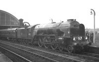 The RCTS <I>'Tyne - Solway Rail Tour'</I> hauled by A1 Pacific no 60131 <I>Osprey</I> takes water at Stockton on 21 March 1965 during a break in its journey from Leeds City to Carlisle via Newcastle.  <br><br>[K A Gray&nbsp;/03/1965]