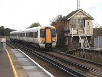 A Southeastern service from Ramsgate to London arrives at Wye between Canterbury and Ashford on 23 October 2010. The Signalbox is no longer in use although the level crossing at the south end of the platform is now worked from the station building.<br> <br><br>[John McIntyre&nbsp;23/10/2010]