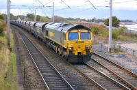 Freightliner 66508 approaches the level crossing with coal empties for Scotland.<br><br>[Bill Roberton&nbsp;19/10/2010]