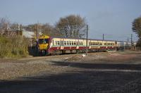 A pair of 334 units head for Edinburgh past the remains of Drumshoreland Station.<br><br>[Bill Roberton&nbsp;02/11/2010]