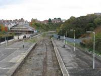 From the footbridge, the remainder of the platform and the island platform are visible, together with a DMU on the Barry Steam Railway tracks. Note the remaining colour light signals!<br><br>[John Thorn&nbsp;28/10/2010]
