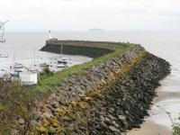 The railway used to continue to Barry Pier where trains would meet the paddle steamers from Weston-super-Mare and other ports across the Bristol Channel. The tracks are just visible on the breakwater in October 2010; the island in the background is Steep Holm.<br><br>[John Thorn 28/10/2010]