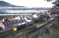 A northbound train from Inverness snakes through Clachnaharry village in the late 1960s.<br><br>[Frank Spaven Collection (Courtesy David Spaven)&nbsp;//]
