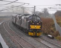 A pair of West Coast Railway class 37s heading west near Forrestfield with a 'Spitfire Railtours' excursion on a grey and wet 6 November 2010.<br><br>[Bill Roberton&nbsp;06/11/2010]