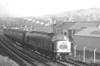 An unidentified <I>Peak</I> takes the 9.30am Edinburgh Waverley - Carlisle/St Pancras train south past Loch Park PW depot shortly after leaving Hawick during the 1968/69 Christmas/New Year period.<br><br>[K A Gray&nbsp;//]