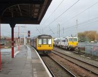 An all stations service from Liverpool via Huyton and Earlestown arrives at Warrington Bank Quay. Running in to the island platform, and passing several stabled track machines, 142048 will shortly retrace its steps back to Lime Street. View north towards Winwick Junction.<br><br>[Mark Bartlett&nbsp;04/11/2010]