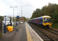 First Great Western DMU 165105 arrives at the staggered - platform Gomshall station on a Redhill to Reading service on 30 October 2010. <br><br>[John McIntyre&nbsp;30/10/2010]
