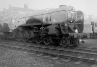 BR Standard class 9F 2-10-0 no 92214 in the shed yard at Woodford Halse (2F) in October 1963. This loco is now preserved, and, as of Oct 2014, is back at the Great Central Railway after being owned by a group of NYMR volunteers, from 2010-13. It is currently in lined green livery, similar to 92220 <I>Evening Star</I>.<br><br>[David Pesterfield&nbsp;20/10/1963]